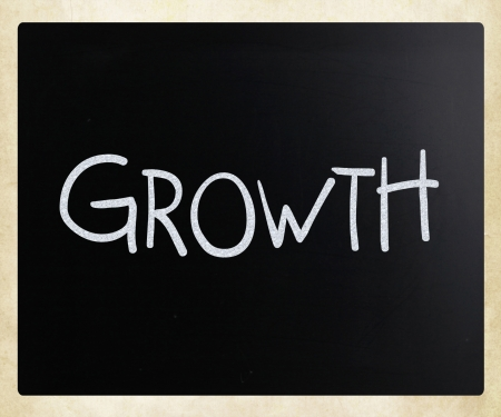 Growth, handwritten with white chalk on a blackboard. photo