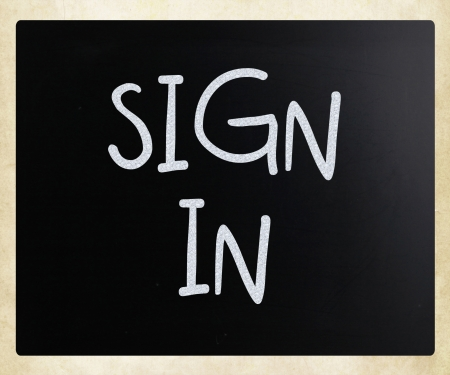 sign in, handwritten with white chalk on a blackboard. photo
