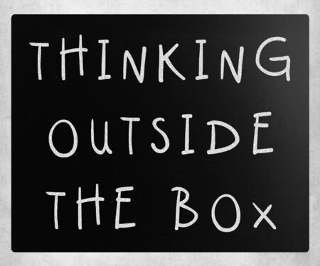 Thinking outside the box phrase, handwritten with white chalk on a blackboard Stock Photo - 14351659