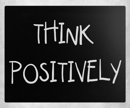 Think Positively handwritten with white chalk on a blackboard photo