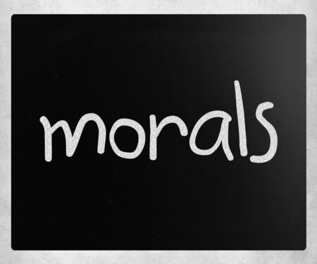 Morals handwritten with white chalk on a blackboard Stock Photo