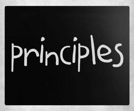 Principles handwritten with white chalk on a blackboard