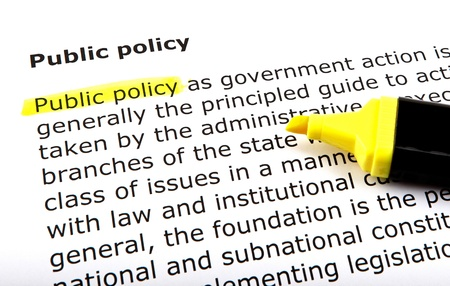 Public policy - Text highlighted with felt tip pen. photo