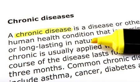 Chronic disease - Text highlighted with felt tip pen. photo