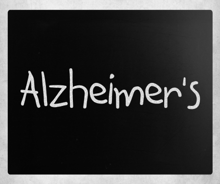 brain aging: The word Alzheimers handwritten with white chalk on a blackboard