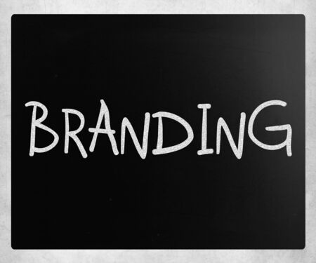 Branding handwritten with white chalk on a blackboard photo