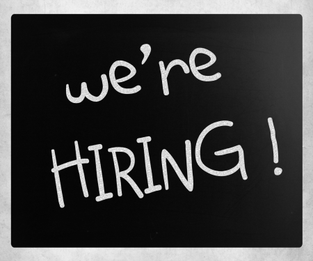 We are hiring! handwritten with white chalk on a blackboard photo