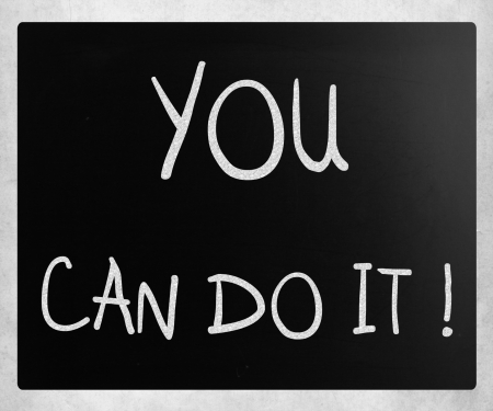 'You can do it' handwritten with white chalk on a blackboard photo