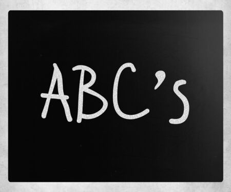 abc's: ABCs handwritten with white chalk on a blackboard Stock Photo