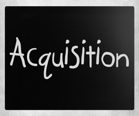 takeover: The word Acquisition handwritten with white chalk on a blackboard