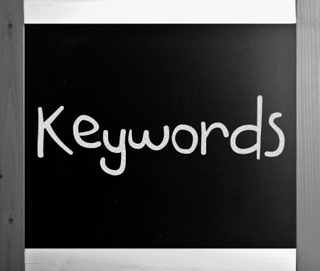 The word Keywords handwritten with white chalk on a blackboard