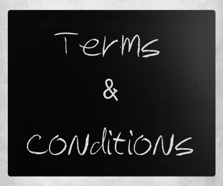 Terms & Conditions handwritten with white chalk on a blackboard. photo