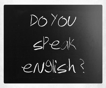 Do you speak english handwritten with white chalk on a blackboard. photo