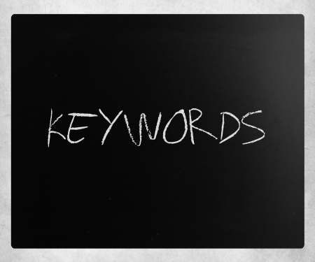 The word Keywords handwritten with white chalk on a blackboard.