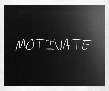 Motivate handwritten with white chalk on a blackboard. photo