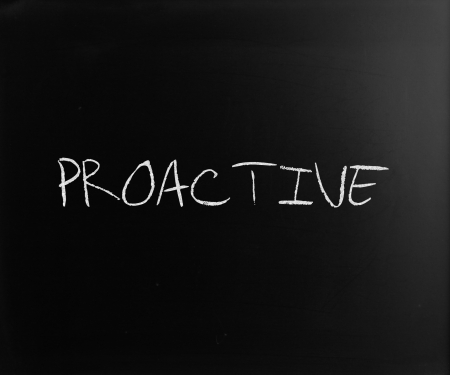 The word 'Proactive' handwritten with white chalk on a blackboard. Stock Photo - 14400938