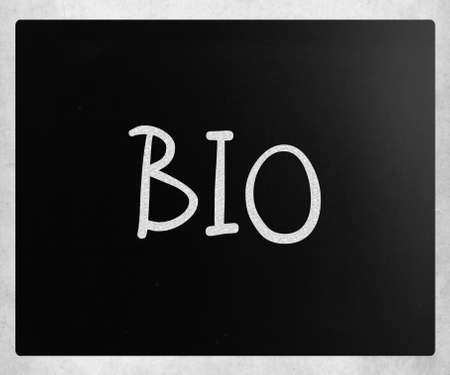 'Bio' handwritten with white chalk on a blackboard. photo