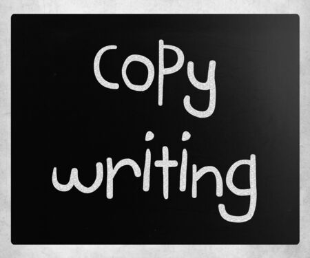 copywriting: Copywriting handwritten with white chalk on a blackboard. Stock Photo