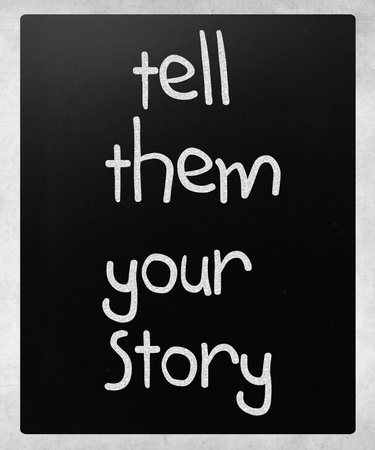 storytelling: Tell them your story handwritten with white chalk on a blackboard