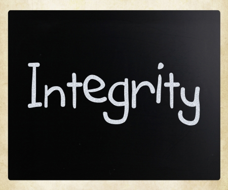 goodness: Integrity handwritten with white chalk on a blackboard.