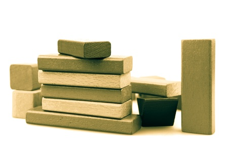 Wooden building blocks isolated on white background. photo