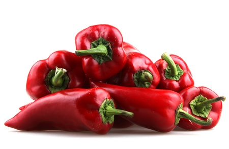 hot peppers: Red chilli peppers on white background.