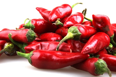 Red chilli peppers on white background.