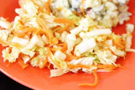 fresh vegetables salad with cabbage and carrot. photo