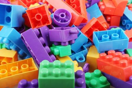 red building blocks: Plastic building blocks.