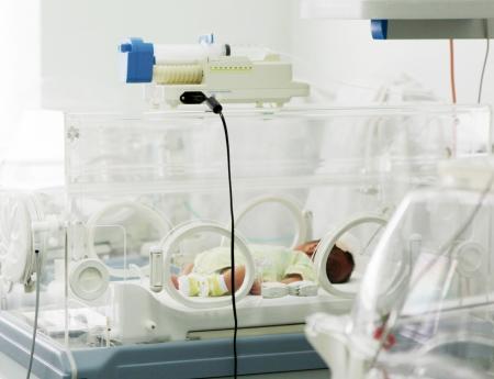 infant girl: newborn baby in hospital.