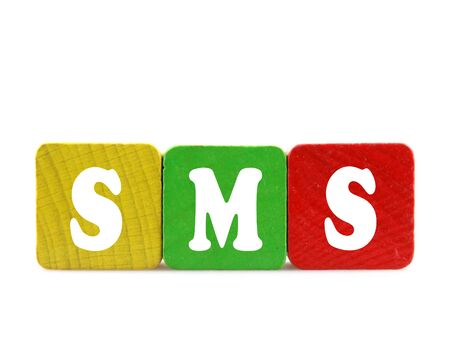 sms  - isolated text in wooden building blocks Stock Photo - 18525451