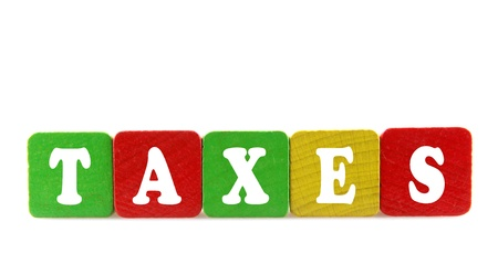 taxes - isolated text in wooden building blocks photo