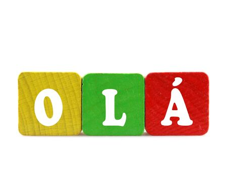 dialects: olá - isolated text in wooden building blocks Stock Photo