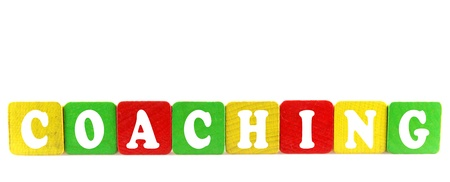 coaching - isolated text in wooden building blocks photo