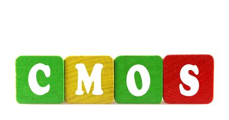 cmos: cmos - isolated text in wooden building blocks Stock Photo