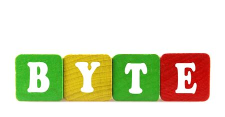 byte: byte - isolated text in wooden building blocks