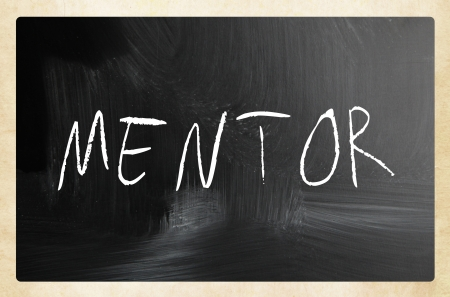 Mentor handwritten with white chalk on a blackboard. photo