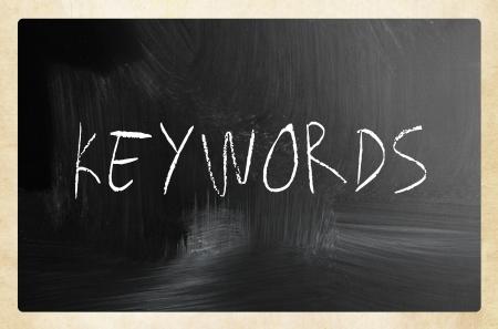 Keywords handwritten with white chalk on a blackboard Stock Photo