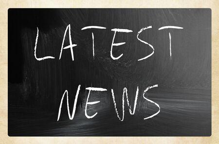 Latest news handwritten with white chalk on a blackboard