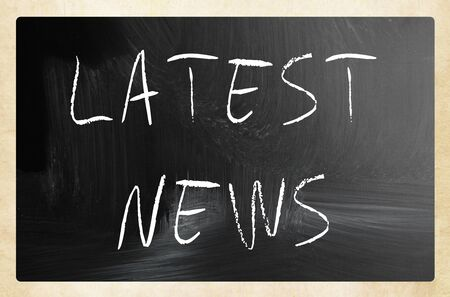 lately news: Latest news handwritten with white chalk on a blackboard