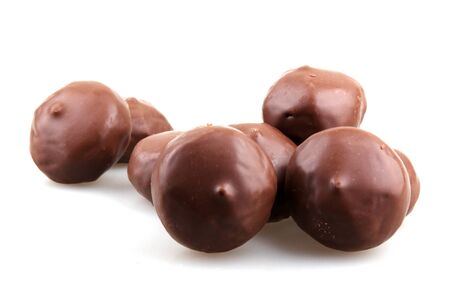 stacked chocolate candy on white background photo