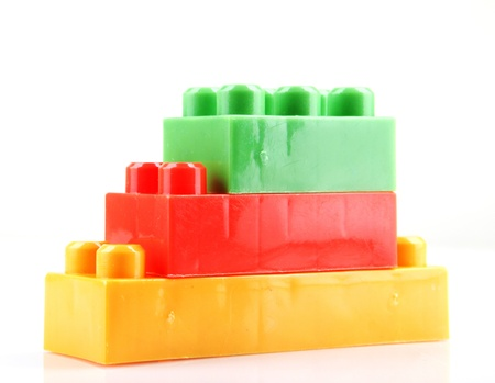 plastic building blocks on a white background photo
