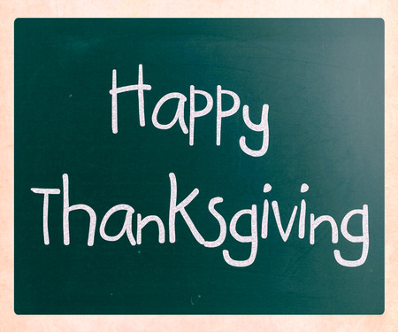 'Happy Thanksgiving' handwritten with white chalk on a blackboard photo