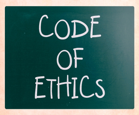 'Code of ethics' handwritten with white chalk on a blackboard photo