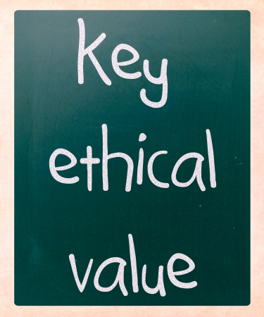 'key ethical value' handwritten with white chalk on a blackboard photo