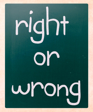 Right or wrong handwritten with white chalk on a blackboard photo
