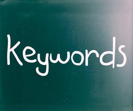 The word Keywords handwritten with white chalk on a blackboard photo