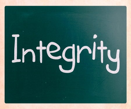 uprightness: The word Integrity handwritten with white chalk on a blackboard