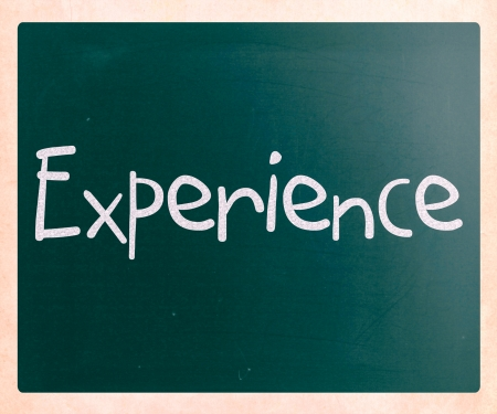 The word 'Experience' handwritten with white chalk on a blackboard photo