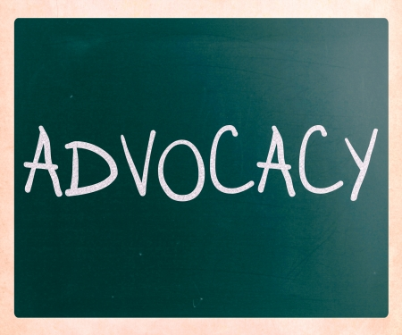 urging: The word Advocacy handwritten with white chalk on a blackboard